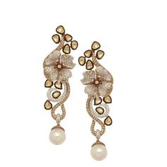 White Cappuccino       These stunning earrings by Anmol are crafted in 18 K and 24 K gold and set with south sea pearls, uncut diamonds, coffee diamonds and white round brilliant diamonds.