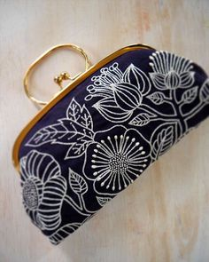 'Deep blue' pouch by Japanese embroidery artist Yumiko Higuchi. What a great way to showcase embroidery. via the artist's blog