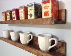 This item is unavailable : Our Rustic Wooden Coffee & Tea Shelves save counter/cabinet space & creates an eye catching display for your kitchen. Its not only stunning, Coffee Cup Storage, Coffee Mug Display, Coffee Cup Holder, Coffee Cups, Bar Shelves, Wooden Shelves, Picture Ledge Shelf, Cadeau Parents, Cocoa Tea