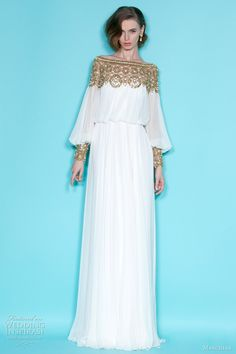 Marchesa Resort 2012 dress. White blouson gown with beads accenting the neckline and cuffs of the bishop sleeves.