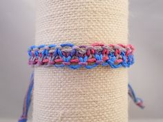 """$8.00 This tie-dye hemp bracelet is handcrafted using a pink/blue/gray variegated hemp that gives a tie-dye appearance. It is adjustable to ensure a custom fit.  Width: Approx. 1/2"""" Adjusts from: 6.5""""-12"""""""