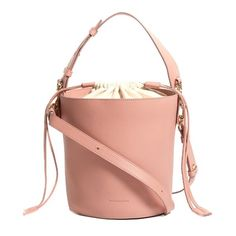 J.W.Anderson Bucket leather and canvas tote (3.753.460 COP) ❤ liked on Polyvore featuring bags, handbags, tote bags, pink, red leather handbags, pink leather tote, pink leather tote bag, red leather tote bag and pink tote