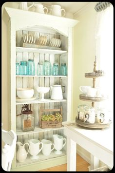 thinking of doing my hutch white , I think the white dishes which I have and the blue mason jars which i have look great.
