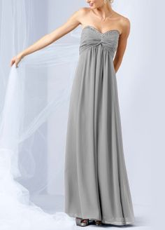 Glamour meets comfort in this dazzling long chiffon dress.  Strapless bodice features eye-catching beading along the sweetheart neckline.  Twist-front bust is flattering and unique.  Empire waist creates an elongated silhouette.  Sheer Chiffon catches the lightbeautifully for a truly radiant look.  Fully lined. Back zip. Imported polyester. Dry clean only.  Available in sizes 0-30 and in extra length in stores.  *Note: Tulle shown in picture is not part of dress.