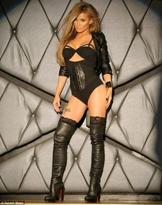 Racy in lace and leather! Carmen Electra poses in over-the-knee boots and vampish corset for her 2014 calendar at Bootsy Bellows in Los Angeles