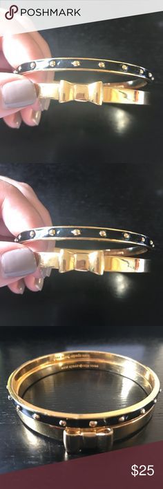 Kate Spade Gold Bow and Black Gold Bangle Set This listing is for two Kate Spade bracelets. Includes a gold bow bangle, and a black bangle with gold stud accents. Stacks well with other bangles. Excellent condition. kate spade Jewelry Bracelets