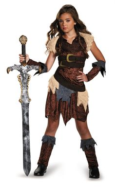 Barbarian Warrior Teen Girl Costume - Bring cute back to the Stone Age with this fun Barbarian Warrior teen costume. It comes with brown velour dress with belts, glovettes and leg warmers. Perfect for Halloween and bringing out the Barbarian Warrior in you. #YYC #CAlgary #costume #Teen #Barbarian
