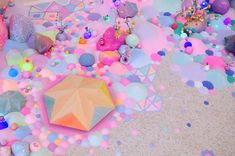 Artist Uses Thousands Of Candies To Turn Rooms Into Sweet Wonderlands - With an overpoweringly colorful and sweet visual style, Australian artist Tanya Schultz creates dazzling works of candy floor art that will make you feel like you just visited Candyland and ate the whole place down to the ground.
