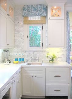 White on white with white marble tile backsplash and blue accents.  Crisp!
