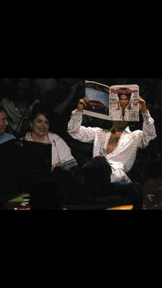 Prince reading about himself in Rolling Stone magazine...LOL or trying to avoid cameras