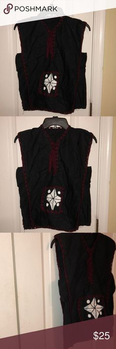 """Africa attire boy's summer top black/wine 6/7 Lovely  Africa attire top for boys. Black with wine crotchet trims on the neck with drawstring, on the arm, hem and round the front pocket. Free style.  Can be worn with pant , short or jeans. Chest laying flat approximately 17"""" and shoulder to hem 22"""". NWOT. Never worn, from a clean , pet and smoke free home. unknown Shirts & Tops Blouses"""