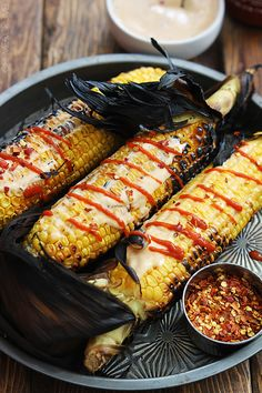 This quick summer side dish is a great way to mix things up with your corn on the cob! Just slather on a spicy Asian sauce and grill em' up! This 15 minute recipe can't be beat!