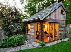 The Backyard House by Megan Lea. Intended as an extra space for an office or as a guest room, the 154 sq ft house was built in a small corner of her vegetable garden in less than six months using salvaged barn lumber and a salvaged copper roof. I'm in love!!!