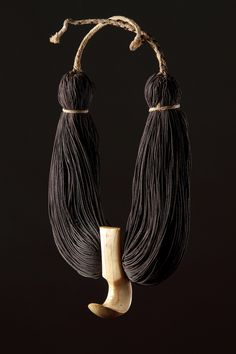 * LEI NIHO PALAOA Royal necklace, Hawaiian Islands, Sperm whale tooth pendant and braided human hair, early 19th century