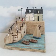 Shell Harbour. #driftwood #shabbydaisies #shabbychic #seagulls #facebook #harbour #boats #sailboat #sailing #driftwoodart #rustic #rusticart #summer #sun #beach #seaside #harbour #nautical #ladder #rowingboat