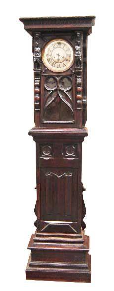 Carved oak figural Gothic clock