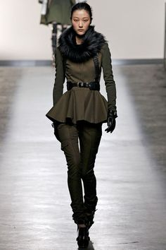 Shopping the Fall Trends: Military With a Twist  Military-inspired cool carries over from last fall, but this year, it's elevated with tailored cuts, edgy-luxe detailing, and inspired interpretations. Take this Prabal Gurung harness-topped riding suit for example—so tough-girl chic.