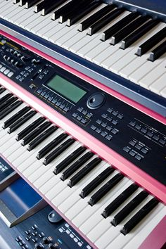 music keyboards and synthesizer on a rack