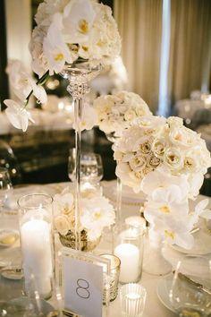 White wedding reception centerpiece idea; featured photographer: Pen Carlson Photography