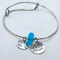 Hand made glass bead and hand stamped bracelet. Sea glass seeker
