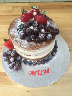 """6"""" naked cake with strawberry jam and vanilla buttercream, decorated with fresh fruit"""