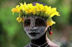 Face painting and embellishments,  Omo valley Ethiopia, photo Hans Silvester