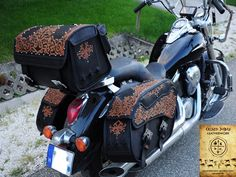 Huge handmade motorcycle bags collection on a Kawasaki VN 900. Handmade saddlebags, and luggage bag decorated with traditional hungarian appliqued leather ornaments and leather lacing. The Best Hungarian Craft Work Of The Year, awarded 2014.