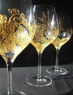 Mehndi Glass. Hand painted one of kind glassware glass art.  Specialized wedding wine glass. Personalization available.  www.mehndiglass.com