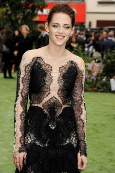 Kristen Stewart caught smiling at the 'Snow White and the Huntsman' world premiere.