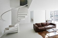 clockwise half spiral staircase in white