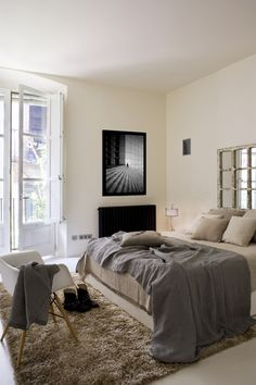 I like the mirrored window frame for a headboard. We're trying to do something for our platform bed and need inspiration.