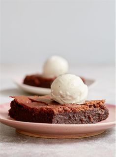 Just when you didn't think brownies could get any naughtier, Mary Berry reveals her recipe for Fondant Brownies in her cookbook, Classic. Moist, soft and ridiculously gooey, this decadent chocolate brownie served with vanilla ice cream makes the ultimate dinner party dessert. They also don't contain flour so are perfect for anyone who can't tolerate gluten. #brownie #baking Mary Berry Chocolate Brownies, Chocolate Fondant, Chocolate Desserts, Decadent Chocolate, Dinner Party Desserts, Homemade Desserts, Delicious Desserts, Brownie Recipes, Brownie Ideas