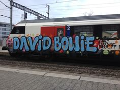 An unspecified train in Switzerland has been grafittied by some local Bowie fans: two of the musician's alter egos bookend the bubble-written tribute on the side of this particular carriage.
