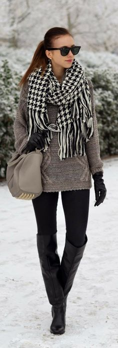 Stripes scarf with grey warm sweater with grey leather hand bag and black pant and black long boots