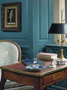 Colefax and Fowler. Love the wall color.