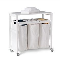 This Mobile Laundry Sorter ($189 at Grandinroad) multitasks with a hinged folding surface.
