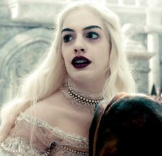 Anne Hathaway as The White Queen in Alice in Wonderland. medium-close up shots often used in both films. Not as uncomfortable as close-ups but still show detail of face or the focus.