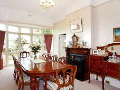 Classic Dining Room Idea With Floorboards Sash Windows