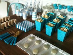 mesa de postres para baby shower de niño con sorpresas