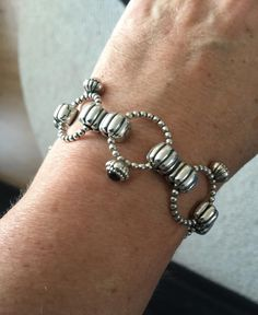 """PANDORA """"Ring"""" Bracelet made with Multiple Rings and Double Clips."""