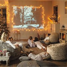 SO cozy!!! Found this on a Christmas group on Facebook - what a wonderful idea to make a screen out of lights on the wall!