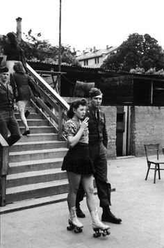 A young woman on roller skates and her soldier , 1940s.