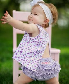 RuffleButts  - The spirit of summer is alive in this feminine and frilly open-back swing top. This classic piece is sure to be a hit, with both parent and child. The cool, comfortable style makes this an everyday play option, yet the cotton lining and fun fabric give it that extra flair for special wear. (From: RuffleButts.com - Sale! $11.50)
