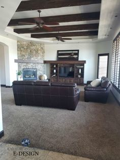 Living room with dark wood beams, trim and tv stand, stone fireplace, brown leather furniture and greige taupe Dark Wood Trim, Dark Wood Floors, Wood Beams, Best Neutral Paint Colors, Room Paint Colors, Paint Colors For Living Room, Dark Wood Living Room, Living Walls, Kylie M