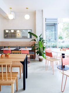 Pink accents contrast the pale palette that US firm ASH NYC has used for the interior of this farm-to-counter restaurant in Boston.