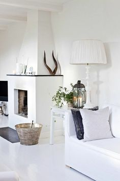 White floors, white walls. Small touches give character and interest whilst keeping an overall theme of white. Love