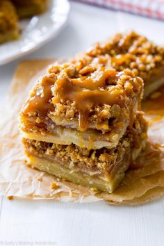 Sweet apple pie bars with a delicious shortbread crust, crumble topping, and salted caramel sauce. Recipe on sallysbakingaddiction.com