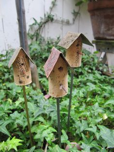 Add charm and whimsy to your garden with several of these adorable cork birdhouse garden stakes!  Each birdhouse is a unique piece of art consisting of a used wine cork, patterned metal roof & brass or steel metal stake. Sizes of cork & roofing vary. Please contact me for