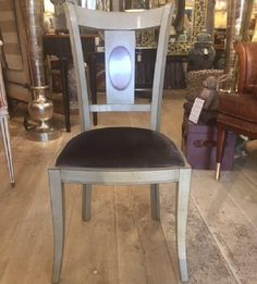 These lovely chairs are made from solid cherry wood.  They are finished in Antique Grey, with natural cherry wood detail to the backsplat and have a smart graphite upholstered seats.