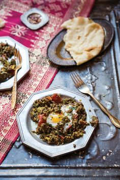 From SAVEUR Issue #166 For this rich, spicy Iraqi breakfast dish, ground lamb is sautéed with onions, tomatoes, and parsley, seasoned to the hilt with bahar asfar, yellow curry powder, and then topped with soft-baked eggs.